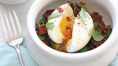 I could eat this meal 17 times a day. Sweet potato hash browns, wilted spinach, and soft-boiled egg topped with torn basil and crispy bacon crumbles.