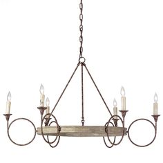"The Gabby Lighting Bailey chandelier updates a traditional silhouette with a transitional feel, perfect for bedrooms, living rooms, and entryways. Large circles in antique-finished rust and white-washed wood create a geometric look. 36""W x 36""D x 26""H. Cord: 6'L. Chain: 6'L. Accepts six 60-watt bulbs (not included). White-washed wood and rust-finished frame and chain. Black cord. Due to the handmade artistry of Gabby's collection, variation between individual produ..."