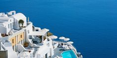 #Santorini, #Greece - Kirini Restaurant and the main pool perch on the cliffside, 300m above the water.