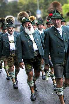 Bavaria - volk costumes (Trachten). Traditional Lederhosen worn by Bavarian country men during a procession.