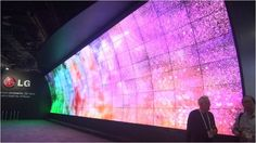 Giant, mind-blowing 3D video wall greets visitors to CES - The entrance to the Main Hall at CES 2014 took attendees a few steps inside the exhibit hall and in front of the largest 3D videowall ever presented at a tradeshow. LG captivated with its approximately 80 ft. by 20 ft. curved wall of 120 high-res screens, all matched perfectly for color, showing a lively program viewed through the same 3D glasses used in theaters. Of course, the LG booth and the rest of the main hall opened up behind…