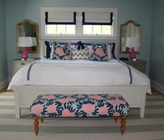 small splashes of #color    light blue walls with navy and pink accents