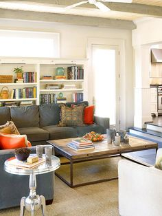 Comfy sectional, lots of books, great coffee table, wood beams, rustic feel. Bookcases behind the sectional.
