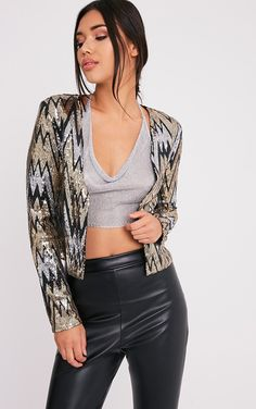 Black Sequin Trophy JacketThis super sleek trophy jacket is a must have in your wardrobe. Featuri...