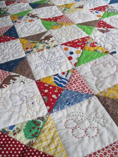 Quilt with embroidery