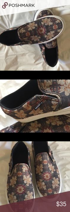 Vans Asher Navy Floral Slip on Sneaker Canvas floral Printed upper Dual elastic panels Cushioned footbed Signature waffle outsole Sneaker is new Never worn Vans Shoes Sneakers