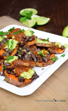 Healthy, simple and delicious, these black bean sweet potato nachos are sure to become one of your favorite game day or weeknight snacks. With just a few ingredients, these gluten free, vegan, dairy free nachos are packed with flavor and so filling. | www.pancakewarriors.com