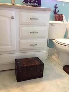 """A """"Treasure Chest"""" step stool for our pirate bathroom. I bought the chest for less than $10 at a craft store. My husband tore out the bottom and built a stool inside to support our kids' weight. I sprayed it with sealant to protect the finish from toothpaste drips, then covered the bottom with felt to protect the floor."""