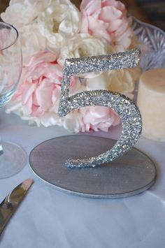 Why not add an actual size number in all bling to number your table, your guest will love the attention to detail!