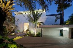 Front facade of a modern Coral Gables House by Touzet Studio.  Read more about Coral Gables real estate at our blog http://coralgablesrealestatevault.com.  #moderncoralgables #coralgableshomes