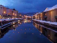 厳寒の小樽運河「小樽雪あかりの路」 Otaru, a port city on Hokkaido (Japan's northernmost island), lies northwest of Sapporo on Ishikari Bay. Completed in 1923, the Otaru Canal, running through the city's center, is lined with cafes and shopping centers in converted old warehouses. Nearby, Sakaimachi Street offers seafood restaurants as well as glass and sweet shops. The city is known for glassworks, music boxes and sake distilleries.