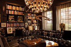 aby rosen art collection   The library with a plesiosaur skeleton hanging from ceiling
