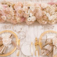 This #blush #reception #tablescape is one for the books! There's no denying that the gilded #chargers and #flatware are the epitome of sleek glamour, but the lush, cloud-like #floral table runner by White Lilac Inc steals the show! Weduxe Magazine