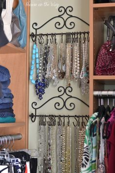 I found two of these towel racks at Hobby Lobby. As you can see, they fit perfectly in the space between two areas of my closet. I spaced them so that I can still reach the top rack of necklaces, which holds the shorter strands. The bottom rack holds the longer necklaces. The necklaces are held on the rack with shower curtain S hooks that I found at Walmart. I made sure to match the finish of the hooks with the towel racks.