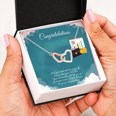 This necklace is a great way to show a special graduate how proud you are of their accomplishment of completing their MBA degree. The message card says: all of your hard work has payed off and you have your MBA. Your determination will help you go far in your career. I know that you are going to do great things. #MBAgraduationgift #MBAgraduationnecklace #giftforMBAgraduate Graduation Necklace, Graduation Gifts, Christmas Gift For You, Perfect Christmas Gifts, Sober, Double Heart Necklace, Love Lily, Two Hearts, Heart Melting