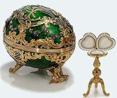 The Rocaille 1902 Faberge egg for the Kelch family, this one was made of gold, platinum, diamonds and silk.  The portraits originally in the frames were lost.