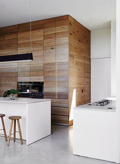Sleek white kitchen island and a smart workstation - Decoist