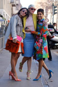 Swanky ladies in colorful prints and hues. Love the mismatched pointy heels!