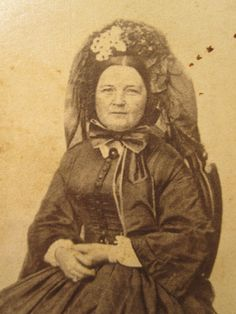 Mary Lincoln wearing a high spoon bonnet with veil thrown back over the crown civil war era fashion