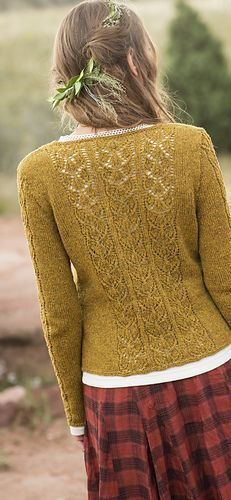 This women's fingering-weight cardigan, part of the larger book collection, Free Spirit Knits, is knit from the bottom hem up in pieces, and then seamed. The front edges and set-in sleeves have a panel of lace leaf motifs, and the back of the cardigan also features a wide panel of lace in the same motif. There is subtle waist shaping for a feminine, slightly trim fit.