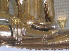 Solid gold Buddha hands