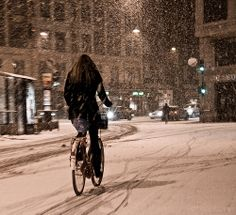 Copenhagen, Denmark.  How can I not want to go somewhere where people still choose to bike in heavy snow?