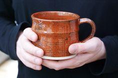 Handmade tea mugs - stoneware pottery mugs glazed in red jasper. £14.00, via Etsy.