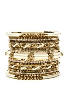 - Bangle set with antique textured 18K gold plated brass bangles with resin beads, Austrian crystal accents and silk threading