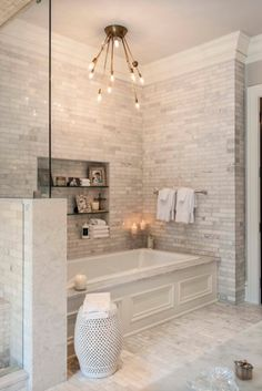 Cream white ceramic tile bathroom with soaker tub