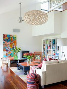 Loving the colors in this living room! Accented by an awesome modern lighting pendant.