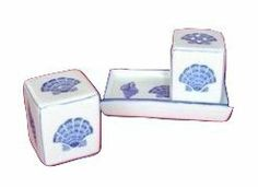 Blue & White Porcelain Cubes Shell Salt & Pepper Shakers by TUI. $25.99. Fine Porcelain Cubes shakers on tray that can be used separately.. Blue & White Porcelain Cubes Shell Salt & Pepper Shakers. The porcelain is entirely hand-painted in deep, rich blue.. The Cubes Shakers measure about 2 inches tall.  The tray measures a little over 4 ½ inches length.. With a hand-painted shell motif.. Fine Porcelain Cubes shakers on tray that can be used separately. With a hand-painted sh...
