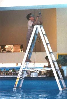 Check this guy out! Metal ladder in a swimming pool with a drop cord on his drill, but he has his safety glasses on, so I guess he gets points for that.