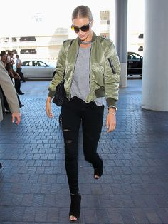 Rosie Huntington-Whiteley Just Wore the Coolest Airport Jacket Ever via @WhoWhatWearAU