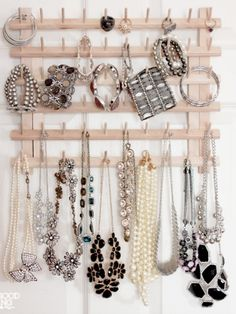 A thread rack becomes the ideal display medium for your statement necklaces, favorite cuffs and special occasion rings. Spray paint it to match your decor. A dark color will make your bling shine.