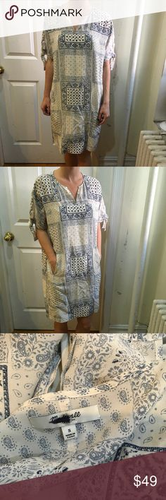 Madewell Cream Blue Paisley Pocketed Shift Dress Madewell dress in a Cream and blue color along with a Paisley print and short sleeves that have tie features! Super shifty and has two cubby pockets in the front- lined and silk blend- worn a few times and is a size small. Looks great belted also! Madewell Dresses Midi