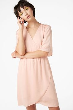 A flowy wrap dress with a slightly ruffled waistline, 3/4 length sleeves and a silky feel. You're welcome! Search 0625682003 on site.