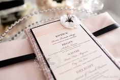 Love this place setting! Napkin, menu with floral appliqué, pearled charger plate, mirror tabletop...