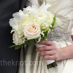 Emily carried a muted bouquet of soft pink roses and white stephanotis.