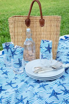 Our Starfish Blue table linens are cheerful and bright, with lovely details that are sure to please. Perfect for any spring or summer gathering, or whenever you're craving a nice pop of color and style. Add some summery seaside charm to your next meal with the Seaside Starfish Collection, available exclusively at Pomegranate. Summer Picnic, Table Linens, Pomegranate, Starfish, Tabletop, Seaside, Color Pop, Straw Bag, Table Settings