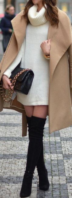 Camel coat over cozy white sweater dress with black OTK boots.