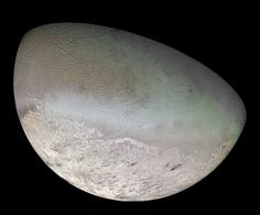 The moon Triton, Neptune's largest satellite. It has a radius of 1,350 (839 mi), about 22% smaller than Earth's moon. Global color mosaic of Triton, taken by Voyager 2 in 1989.