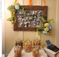 Guests took home cookies in goodie bags that matched the couple's colors. Above is a grapevine screen that has pictures of the couple as children. Photo by Jen Kroll Photography.