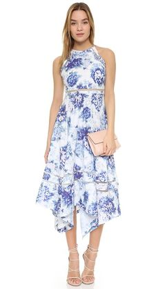 A graceful, feminine dress with delicate lattice detailing and a revealing halter neckline  - get even more style and shopping inspiration on http://jojotastic.com/shop-my-favorites/