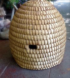 Directions for making a bee skep--hard to keep bees in (can't harvest honey) but pretty to look at...