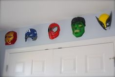 Use Halloween masks to make great, low-cost wall hangings. | 23 Ideas For Making The Ultimate Superhero Bedroom