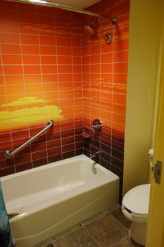 pictures of the bathrooms at art of animation lion king | and a toilet and tub/shower in the other, with a reprise of the lovely ...