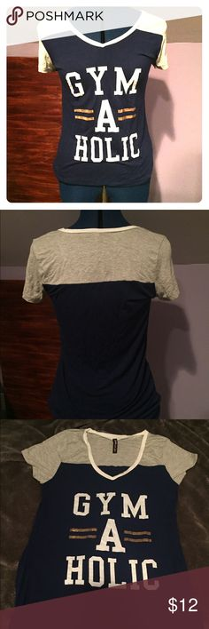"Dark Blue ""Gym-A-Holic"" Top Dark blue and grey shirt with ""gym-a-holic"" printed on the front. Very comfy. Good for sleepwear. Used but in perfect condition. Feel free to make offers. electric Pink Tops Tees - Short Sleeve"