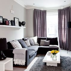 Create a traditional, sophisticated scheme in your living room with a grown-up shade of purple. Set it against a grey backdrop so the daring palette breathes life into a neutral scheme. Full-length curtains add a luxurious touch and keep the room nice and