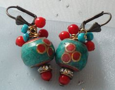 Technique I could use, adding the small beads at top to the jump ring.      Vintage Nepalese jewelry earrings - Ethnic jewelry earrings - Tribal earrings - Turquoise and coral jewelry earrings. $25.00, via Etsy.