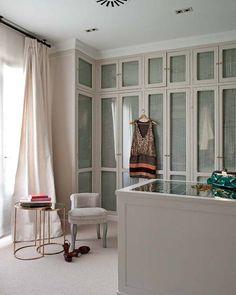 dream closet with mirrored island + window
